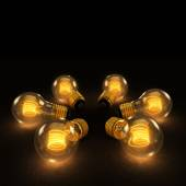 Six Incandescent Lightbulbs in a circle on dark background — Stock Photo