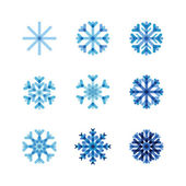 Set of snowflakes of blue shades — Stock Vector