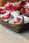 Rose petals in cup — Stock Photo
