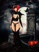 Goth girl in cemetary on halloween night — Stockfoto