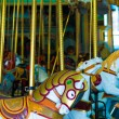 Old-fashioned carousel horses — Stock Photo #64480771