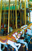 Old-fashioned carousel horses — Stockfoto