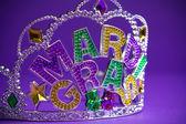 Mardi Gras crown on a purple background — Stock Photo