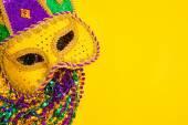 Mardi Gras Mask on yellow Background — Stock Photo