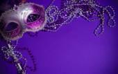Purple Mardi-Gras or Venetian mask on purple background — Stock Photo