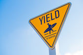 Yield to surfer sign in Southern California — Stock Photo