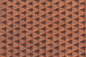 Rusty patterned background on man-hole cover — Stock Photo