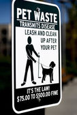 """Clean up after your pet"" signage — Stock Photo"