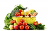 Shopping basket with groceries isolated on white — Stock Photo