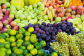Variety of fresh organic fruits on the street stall — Stockfoto