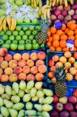 Variety of fresh organic fruits on the street stall — Foto Stock