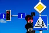 Traffic lights over blue sky — Stock Photo