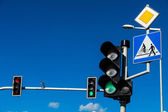 Traffic lights over blue sky — Stock Photo