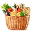 Groceries in wicker basket isolated on white — Stock Photo #55684185