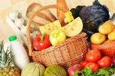 Groceries in wicker basket — Stock Photo