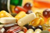 Composition with dietary supplement capsules and containers — Stock Photo