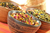 Composition with tea leaves in bowls — Stock Photo