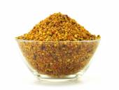 Bowl with bee pollen isolated on white. Nutritional supplement — Stock Photo