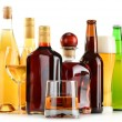 Bottles and glasses of assorted alcoholic beverages over white — Stock Photo #58230739