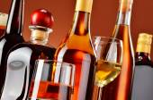 Bottles and glasses of assorted alcoholic beverages — Stock Photo