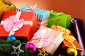Colorful gift boxes and christmas tree — Stock Photo
