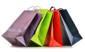 Colorful paper shopping bags isolated on white — ストック写真