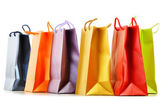 Colorful paper shopping bags isolated on white — Stock Photo