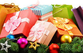 Colorful gift boxes and paper bags isolated on white — Stock Photo