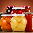 Jars with fruity compotes and jams. Preserved fruits — Stock Photo #59911053