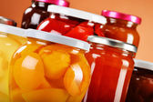 Jars with fruity compotes and jams. Preserved fruits — Stock Photo