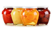Jars with fruity compotes isolated on white. Preserved fruits — Stock Photo
