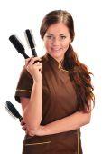 Professional hairdresser holding brushes — Stock Photo