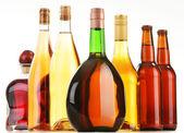 Bottles of assorted alcoholic beverages isolated on white — Stock Photo