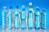 Composition with assorted plastic bottles of mineral water — Stock Photo