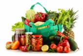 Green shopping bag with groceries isolated on white — Stock Photo