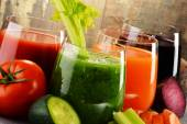 Glasses with fresh organic vegetable juices on wooden table — Stock Photo