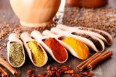 Variety of spices on kitchen table — Stock Photo