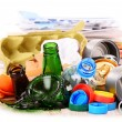 Recyclable garbage consisting of glass, plastic, metal and paper — Stock Photo #69597731
