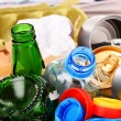 Recyclable garbage consisting of glass, plastic, metal and paper — Stock Photo #69597767