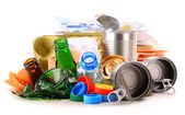 Recyclable garbage consisting of glass, plastic, metal and paper — Stock Photo