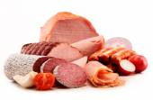 Meat products including ham and sausages isolated on white — Stock Photo