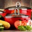 Composition with red steel pots and variety of fresh vegetables — Foto de Stock   #81604014