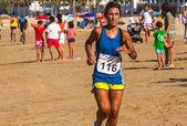 XXV Athletic traverse Rota's beaches — Stock Photo