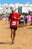 XXV Athletic traverse Rota's beaches — Stock Photo