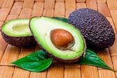 Several cutting avocados — Stok fotoğraf