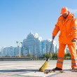 Road sweeper cleaning city street with broom tool — Stock Photo #54994531