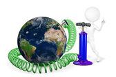 White man pumps a planet Earth — Stock Photo