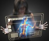 Woman and hologram with bones radiography — Stock Photo