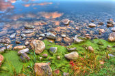 HDR of River edge rocks — Stock Photo