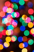Glowing Christmas lights background in soft focus — 图库照片